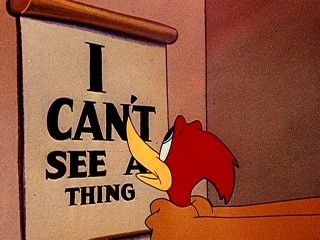 卡通人物啄木鳥伍迪(Woody Woodpecker) 在1946年的短片「魯莽駕駛」(The Reckless Driver)中進行視力測驗的片段。 圖片取自維基百科,Copyright: Walter Lantz Productions, 1946.